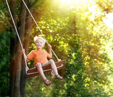 kid on swing
