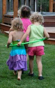 little girls playing hula hoop