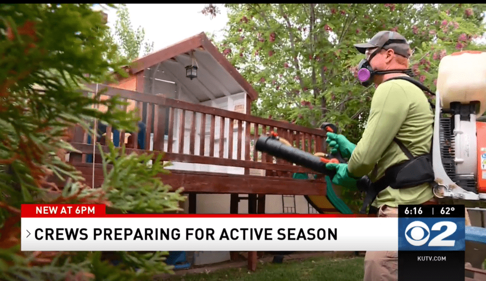 man spraying for mosquito season
