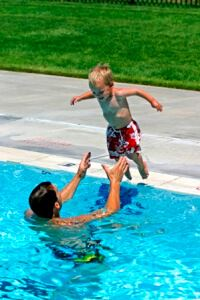 dad and kid in pool