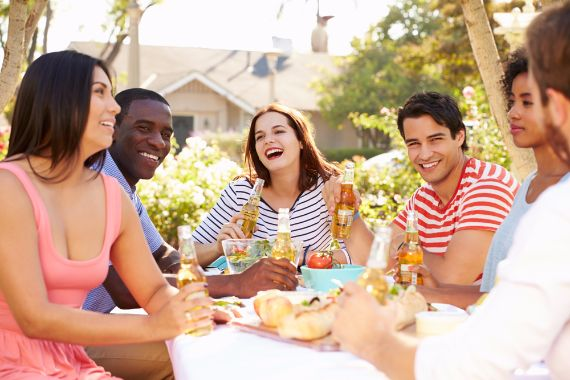 Group of friends enjoying an outdoor picnic